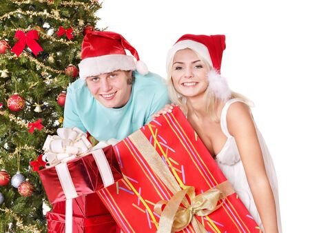 Happy parent in santa hat holding gift box.  Isolated. photo