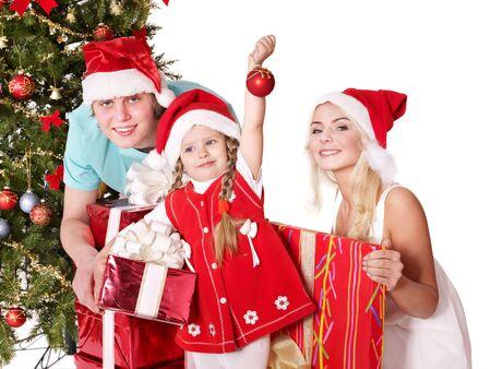 Happy family in santa hat holding gift box.  Isolated. photo