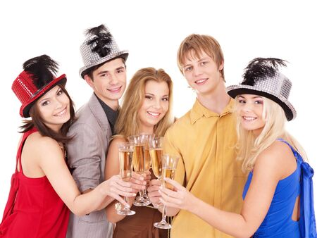 Group young people in party hat drinking champagne. Isolated. photo