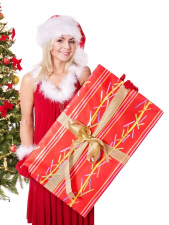 Girl in santa hat holding gift box near christmas tree.  Isolated. Stock Photo - 8332964