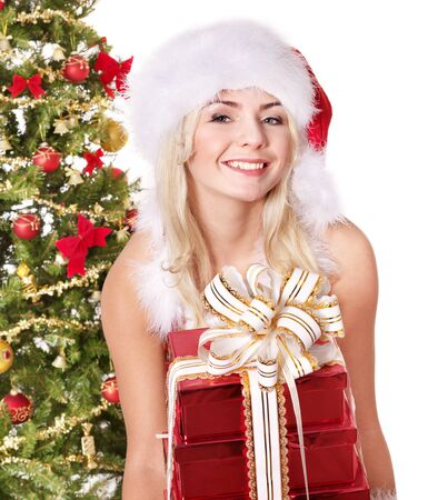 Girl in santa hat holding stack gift box near christmas tree.  Isolated. Stock Photo - 8332948
