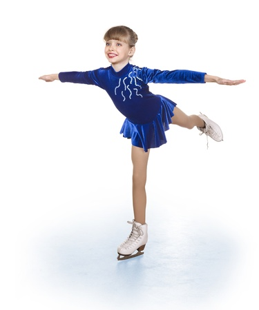figure skates: Happy young girl figure skating. Isolated.