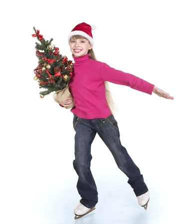 Happy young girl figure skating with christmas tree.. Isolated. Stock Photo - 8383345