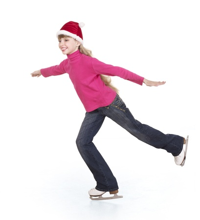 Happy young girl figure skating. Isolated. Stock Photo - 8383343