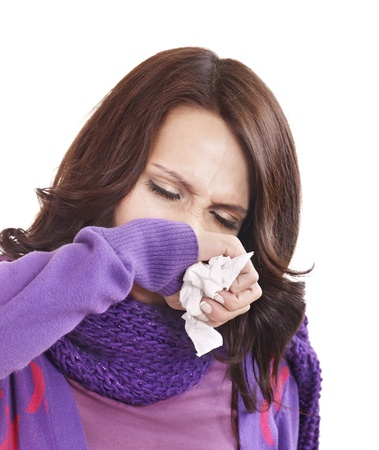 Young woman with handkerchief having  cold. Isolated. Stock Photo - 8436518
