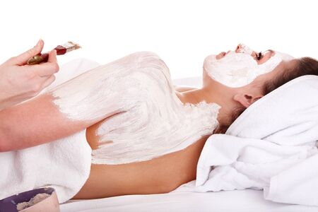 Beautician apply clay body mask  to girl. Skin care. Stock Photo - 8781385
