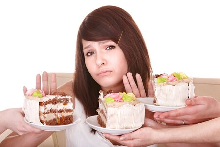 Girl refuse to eat pie. Isolated. photo