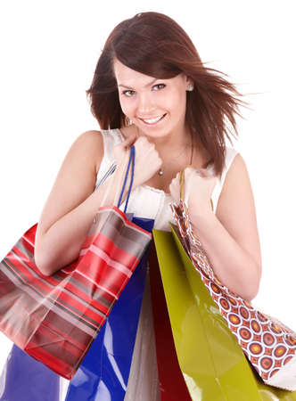 Young woman holding group shopping bag. Isolated photo
