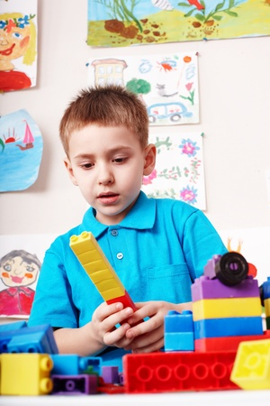 Little boy preschooler  playing block and construction set.  photo
