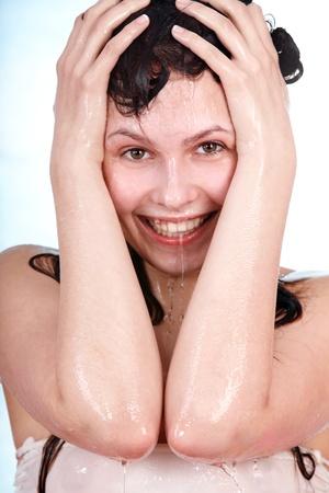 damping: Beautiful young woman  take shower.