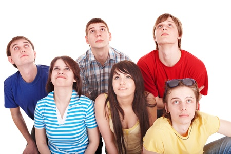 Group of happy young people looking up. Isolated. photo