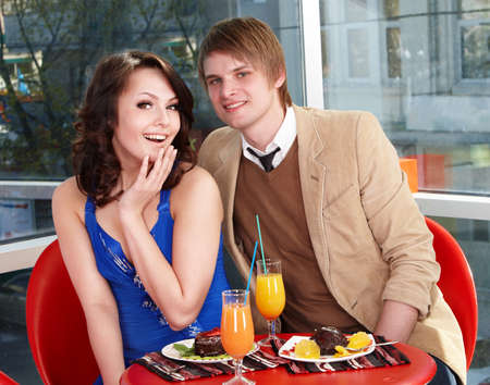 Loving couple on date in restaurant. photo