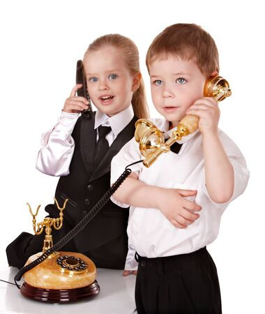 Children in business suit with telephone. Isolated. Stock Photo - 8781198