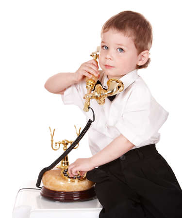 Boy in business suit with telephone. Isolated. Stock Photo - 8781263