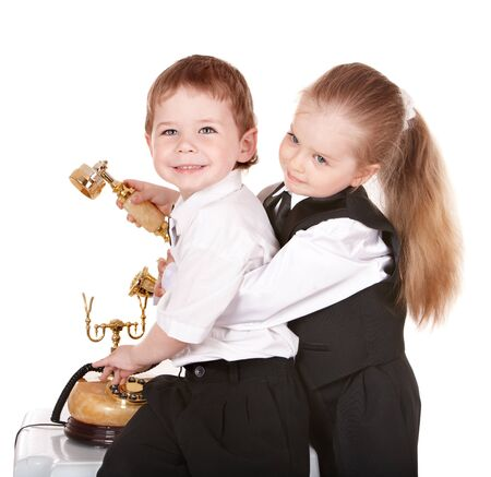 Children in business suit with telephone. Isolated. Stock Photo - 8781180