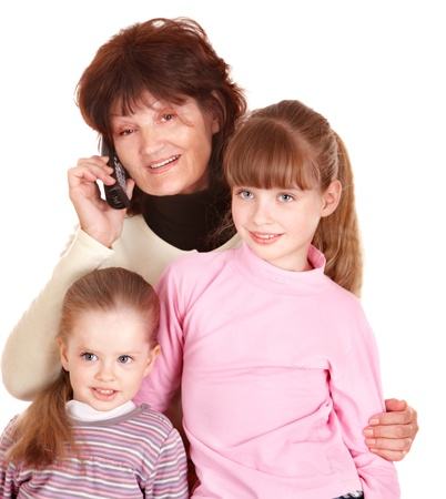 Grandmother and granddaughter talk on phone. Isolated. photo