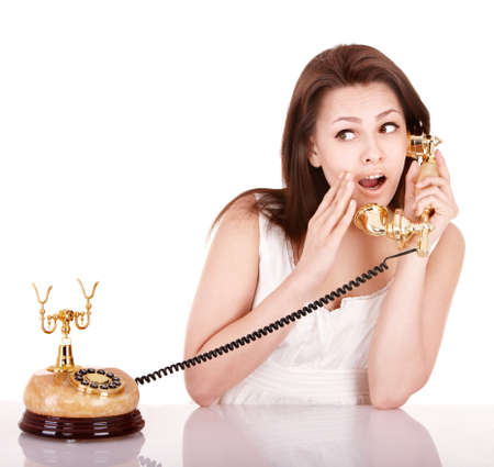 Young beautiful woman calling by phone. Isolated. Stock Photo - 8781127