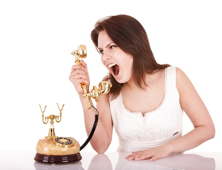 Aggressive young woman with phone.  Isolated. Stock Photo - 8781264
