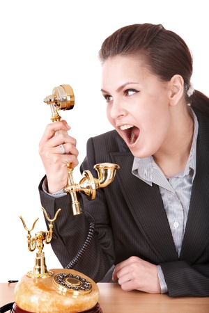 Aggressive businesswoman  talking by  golden  phone. Isolated. Stock Photo - 8781635