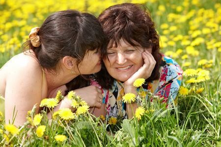 tribal park: Grandmother with daughter in outdoor. Summer.
