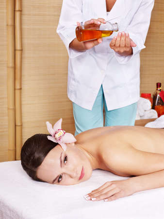 Young beautiful woman on massage table in beauty spa. Series. Stock Photo - 8781716
