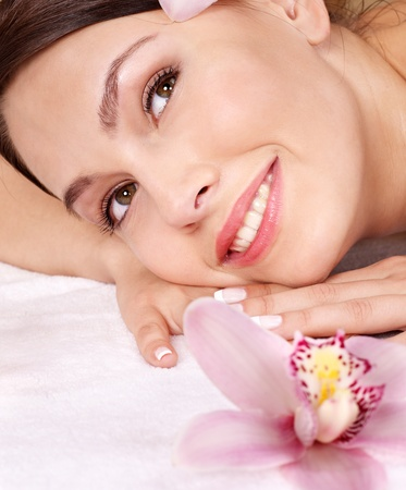 Young beautiful woman on massage table in beauty spa. Series. Stock Photo - 8781644