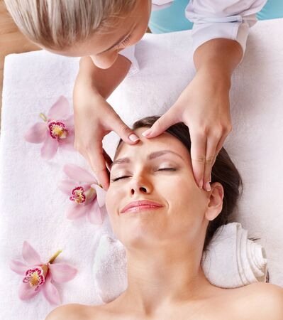 facial spa: Beautiful young woman having massage. Stock Photo