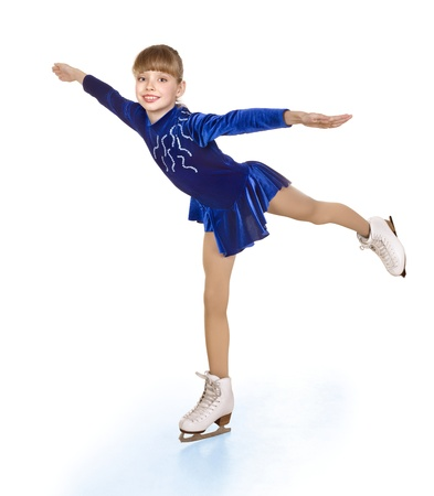skate: Happy young girl figure skating. Isolated.