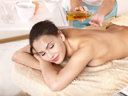 oil massage: Young woman having classical massage in beauty spa. Series.