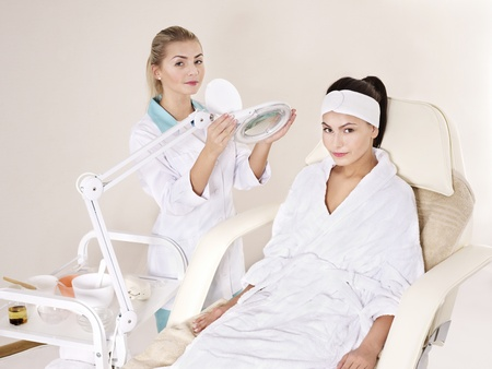 esthetician: Young woman on massage table in beauty spa. Series.