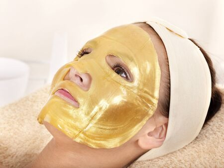 body mask: Young womanl with gold facial mask. Stock Photo