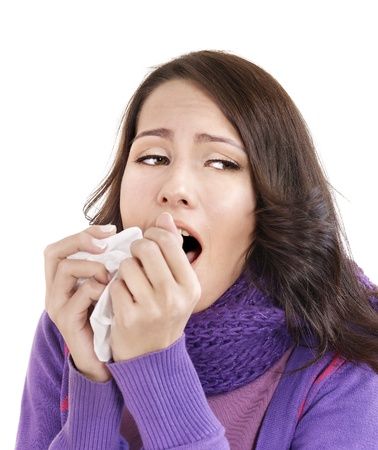 cough: Young woman with handkerchief having  cold. Isolated.