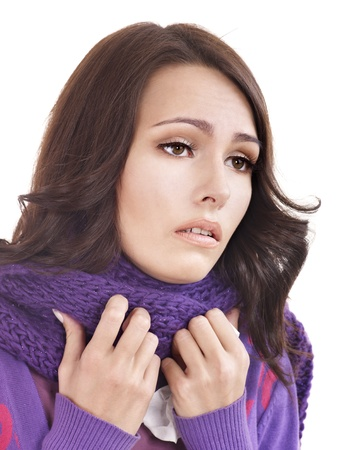 Young woman with handkerchief having  cold. Isolated. photo