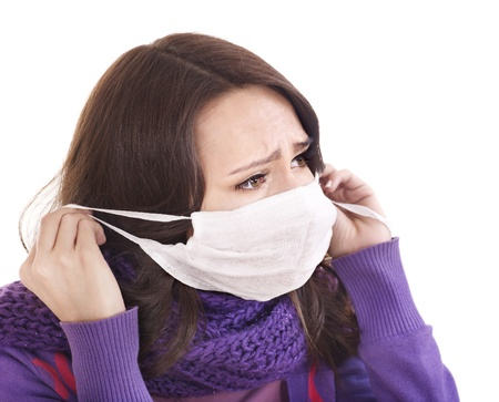 Sick young woman in medical mask.