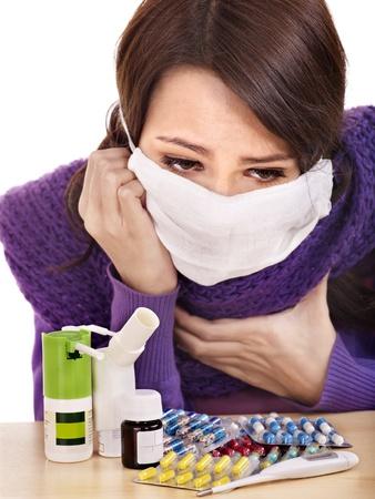 tonsillitis: Young woman having flu takes pills.