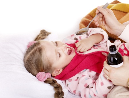 Sick child take  medicine with doctor. Isolated. photo