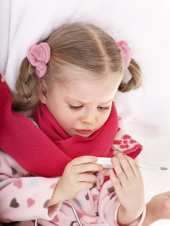 Child checking temperature by thermometer. Stock Photo - 8781850