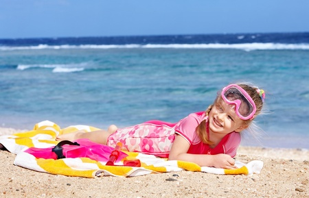 Little girl  playing on  beach. Stock Photo - 8781977