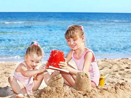 Little girl  playing on  beach. Stock Photo - 8781999