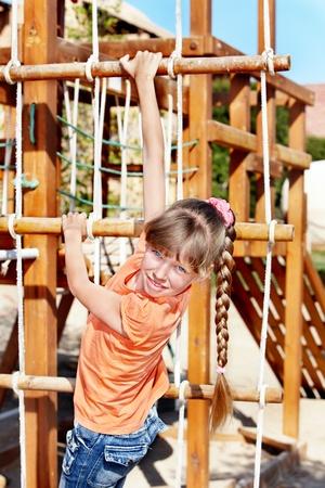 Child climbing on slide. Playground. photo