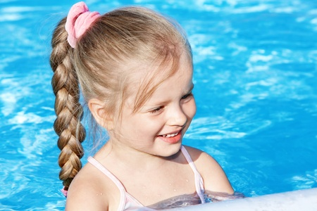 Little girl  swimming in pool. Stock Photo - 8782001