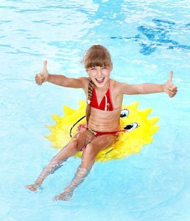 Children sitting on inflatable ring in swimming pool. Stock Photo - 8781890