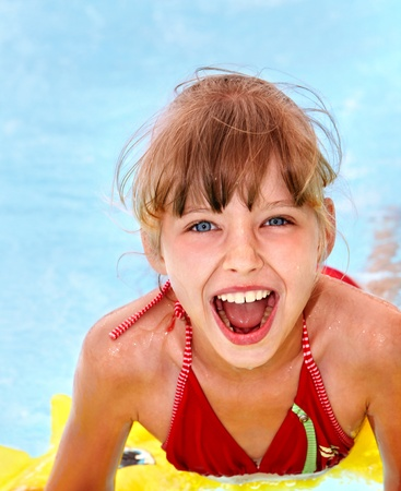 Children  on inflatable ring in swimming pool. Stock Photo - 8781904