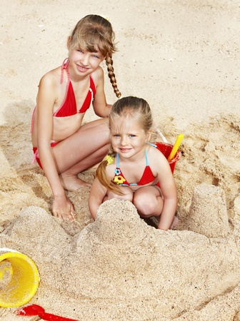 Little girl  playing in sand. Stock Photo - 8782005