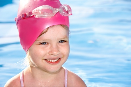 Little girl  swimming in pool. Stock Photo - 8781896