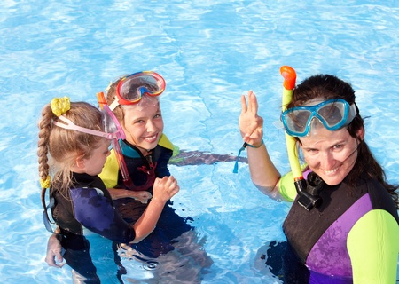 scuba woman: Children in swimming pool learning snorkeling. Sport. Stock Photo