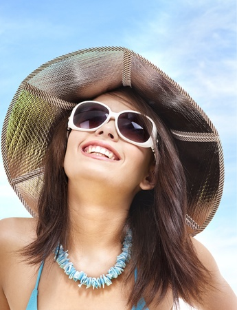 Girl in bikini and sunglasses on beach. Vacation. Stock Photo