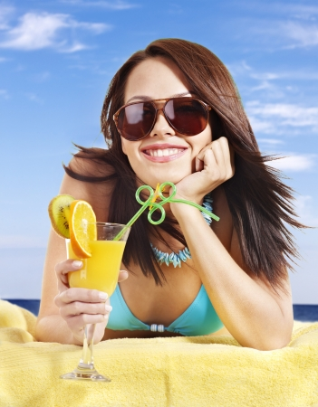 Girl in bikini drink juice through a straw. Stock Photo - 8781939