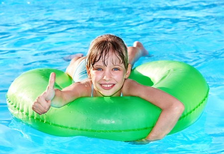 Children sitting on inflatable ring in swimming pool. Stock Photo - 8781998