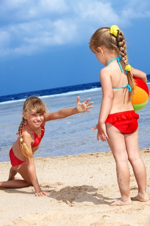 Little girl  playing on  beach with ball. Stock Photo - 8942190